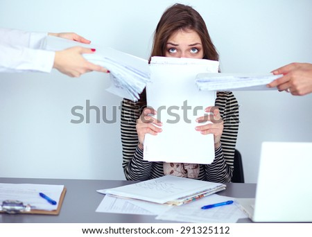 Portrait of tired young business woman with laptop computer - stock photo