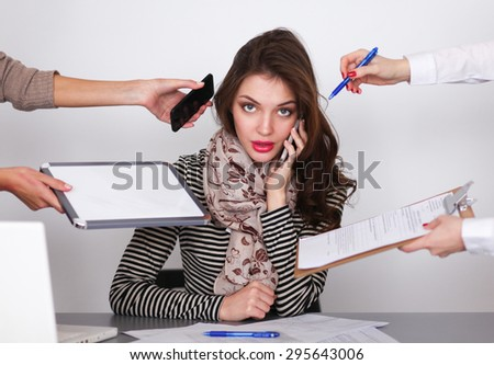 Portrait of tired young business woman with laptop computer. - stock photo