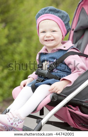 portrait of toddler sitting in a pram