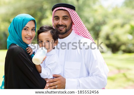 portrait of traditional muslim family outdoors - stock photo