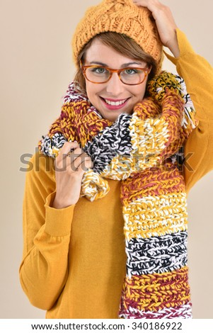 Portrait of trendy girl with eyeglasses and winter accessories - stock photo