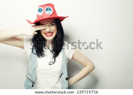 Portrait of Trendy Hipster Girl in Red Hat, studio shot  - stock photo