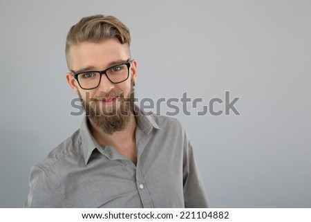 Portrait of trendy man with beard and glasses