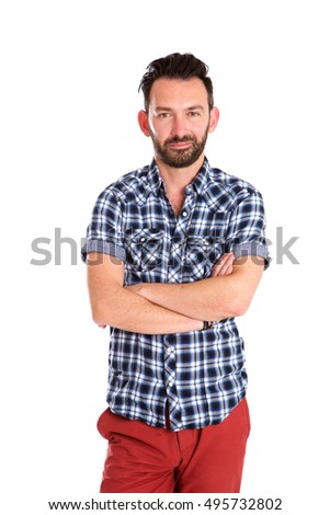 Portrait of trendy mature man standing with arms crossed over white background