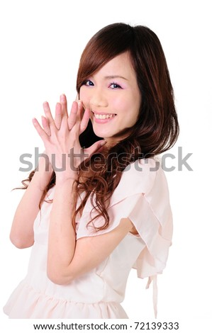 Portrait of trendy young woman in funky pink dress smiling against white background