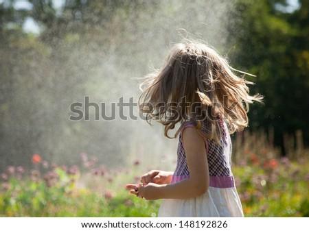 Portrait of turning little girl - stock photo
