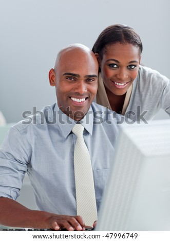 Portrait of two Afro-American colleagues working at a computer in the office