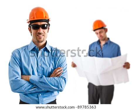 Portrait of two architects working together - stock photo