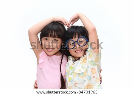 Portrait of two asian girls and best friends with heart sign isolated on a white background. - stock photo