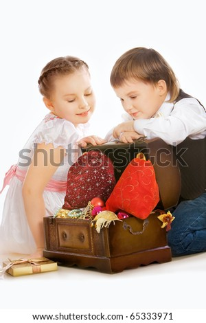 Portrait of two beautiful  child with christmas gifts