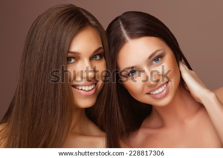Portrait of two Beautiful Women with Long Hair and Clean Skin. Fashion Beauty Model Girls with Make-up - stock photo
