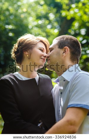 Portrait of two beautiful young lovers in the park
