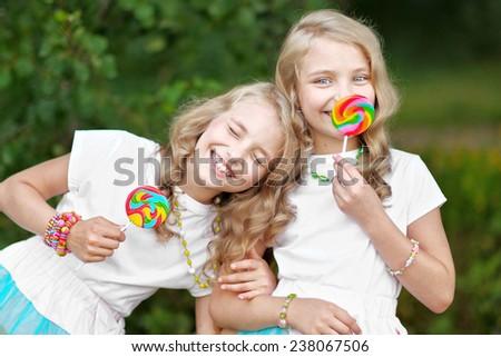 Portrait of two beautifullittle girls twins - stock photo