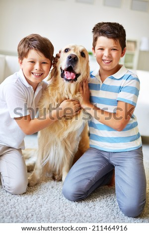 Portrait of two boys with a dog - stock photo