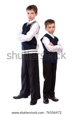 Portrait of two brothers in school uniform, isolation - stock photo