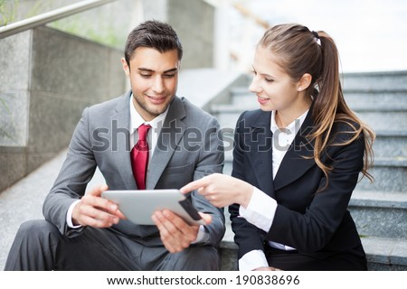 Portrait of two business partners outdoor - stock photo