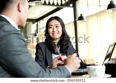 portrait of two business people meeting at cafe during break time at cafetaria - stock photo