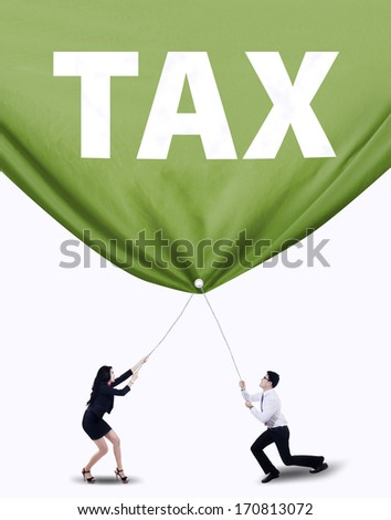 Portrait of two business people pulling tax banner. Isolated on white background