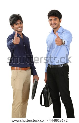 Portrait of two businessmen showing thumps up on white background. - stock photo
