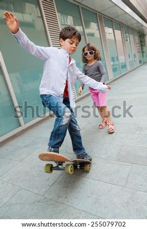 portrait of two children on the sidewalk - stock photo