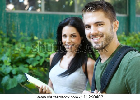 portrait of two college students on campus - stock photo