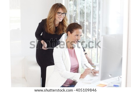 Portrait of two creative businesswoman working together at office.  - stock photo