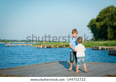 Portrait of two cute brothers walking in the outdoor - stock photo
