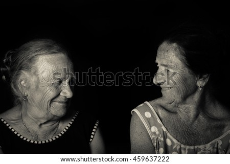 Portrait of two elderly sisters. Smile. Toned.