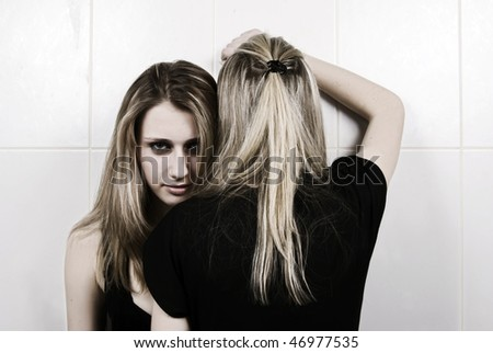 Portrait of two embracing girls - stock photo