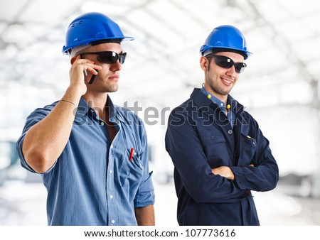 Portrait of two engineers at work - stock photo