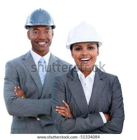 Portrait of two ethnic architects with crossed arms against a white background - stock photo