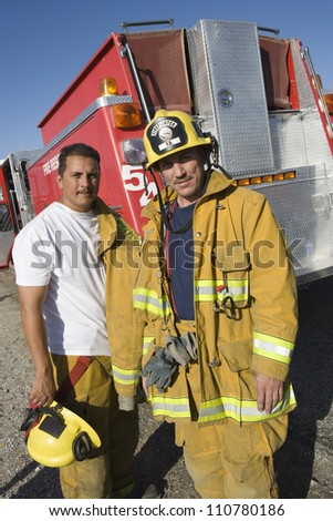 Portrait of two firefighters - stock photo