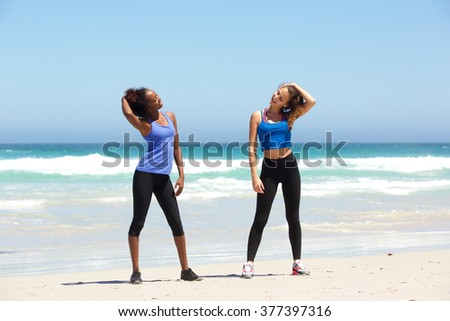 Portrait of two fit young women enjoying workout at the beach