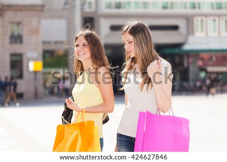 Portrait of two friends shopping together - stock photo