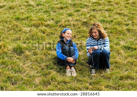portrait of two girls chatting outside