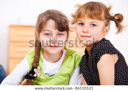 Portrait of two girls indoors