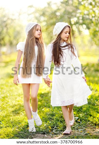 portrait of two girls on a summer nature - stock photo