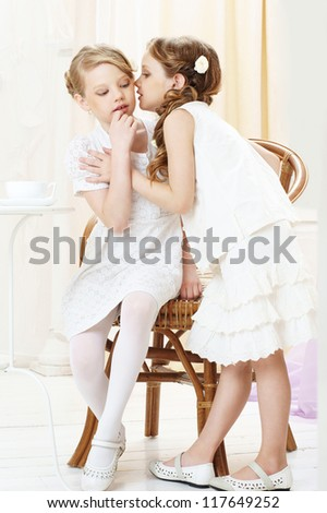 portrait of two gossiping girls - stock photo
