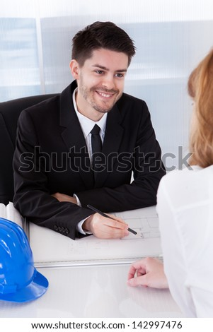 Portrait of two happy architects working in office - stock photo