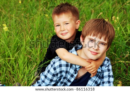 Portrait of two happy boys brothers outdoors. - stock photo