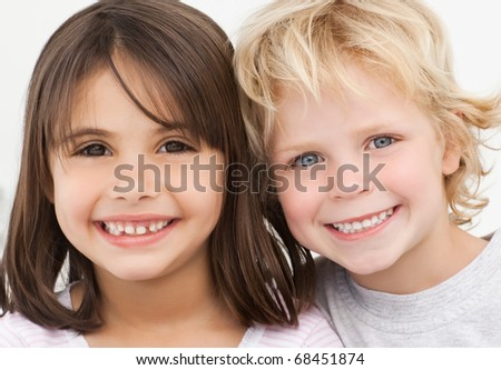 Portrait of two happy children in the kitchen at home - stock photo