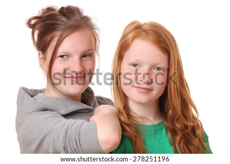Portrait of two happy teenage girls on white background - stock photo