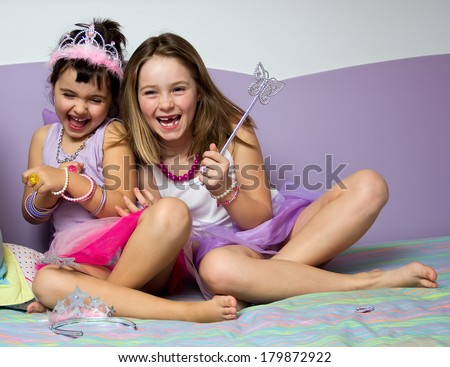 Portrait of two little girls dressed in princess - stock photo