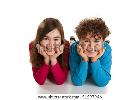 Portrait of two lying kids isolated on white background