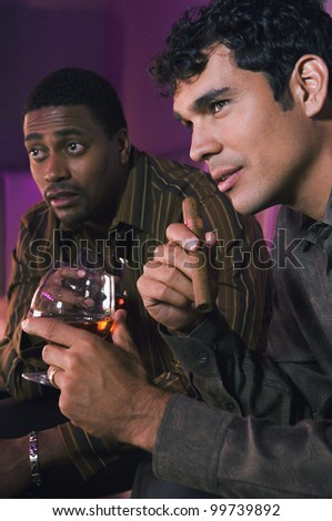 Portrait of two men holding drinks - stock photo