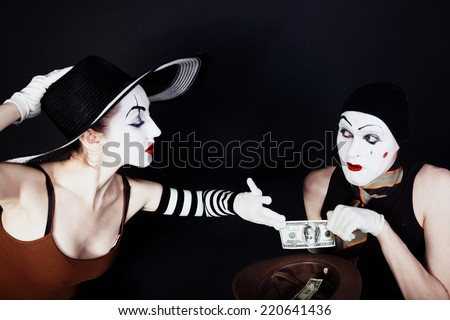 Portrait of two mimes on a black background - stock photo