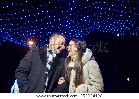 Portrait of two people in love. new years. illumination and boke. - stock photo