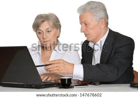 portrait of two people working with a notebook��� on a white background - stock photo