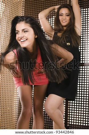 portrait of two pretty girls enjoying party