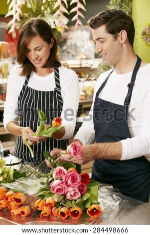 Portrait Of Two Sales Assistants In Florists Shop - stock photo